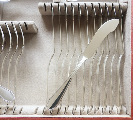 Beautiful vintage silver fish cutlery, detail of  knife set in the case