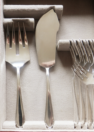 Beautiful vintage silver fish cutlery, detail of  server flatware and forks Stock Photo