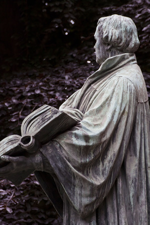 Berlin, Martin Luther statue holding the reformed bible