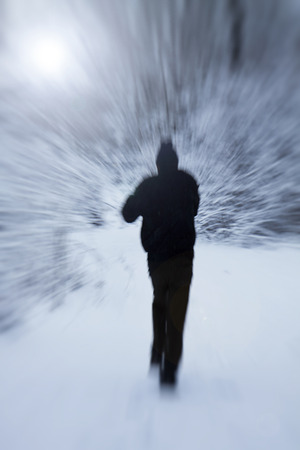 Motion blur, jogger running in the snow