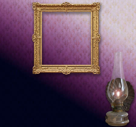 Still life, vintage golden frame  on  stylized vintage Victorian wallpaper and an old iron lamp Stock Photo