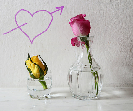 Simple Valentines love: heart on the wall and roses on the table