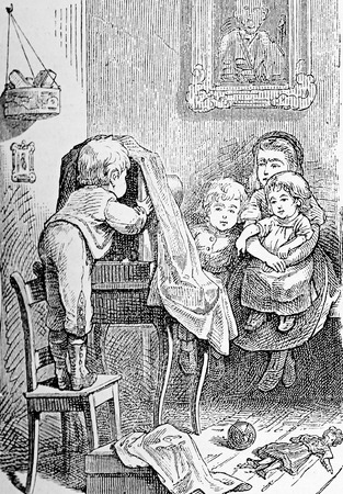Vintage caricature and humor: children game, the small photographer mimicking at home an atelier