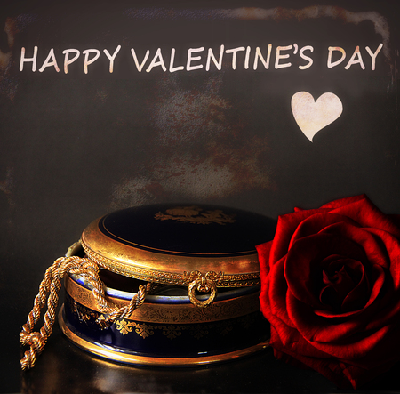 Happy Valentines day with a jewelry ancient box and a gorgeous red rose