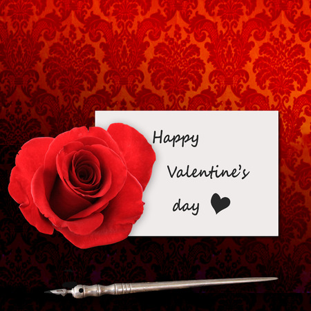 happy Valentine's day, romantic message written with ink and an old pen near a gorgeous red rose Stock Photo