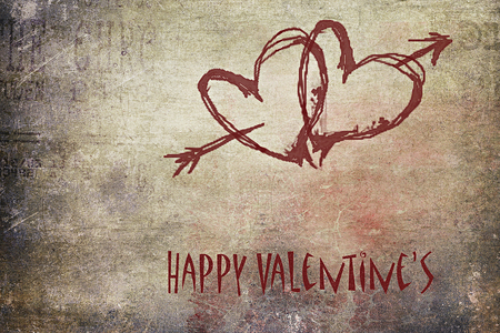 Two red hearts and an arrow painted on a grunge wall, happy Valentine's day