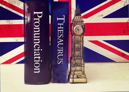 English language thesaurus and pronunciation dictionary near a tacky Big Ben reproduction on a grunge Union Jack background Stock Photo