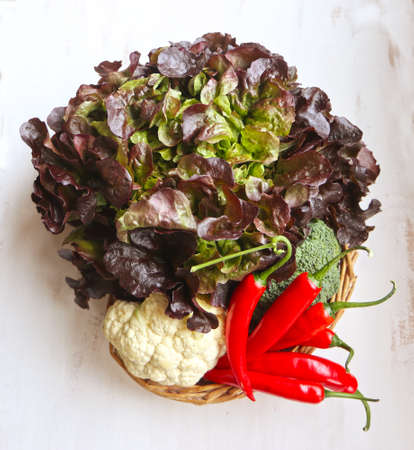 Red batavia lettuce, cauliflower and red peppers: ingredients of summer salads