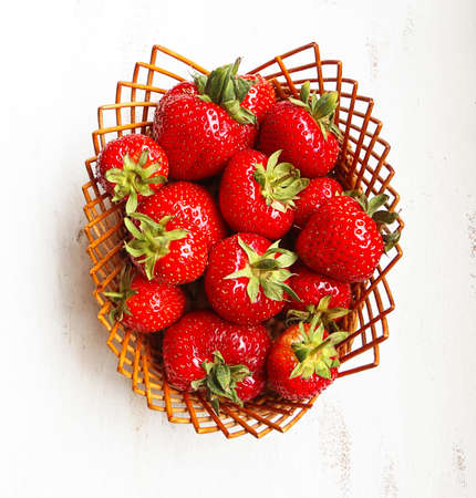 Basket with ripe and red strawberries top view Stockfoto