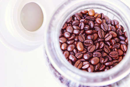 Roasted coffee grains in glass vase with hermetic cap to preserve the aroma