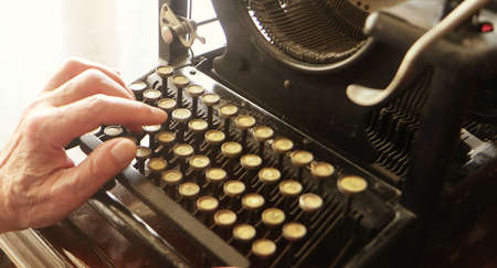 writing with an old typewriter Banco de Imagens