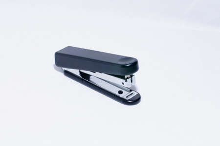 Stapler and staples on a white background  Stock Photo