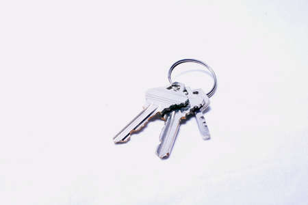 House keys with a blank keyring fob for your logo or graphic Stock Photo