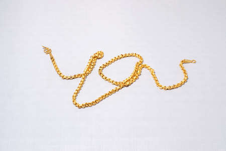 Golden Close-up holding gold necklace Stock Photo - 13087099