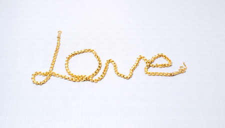 LOVE golden necklace Stock Photo - 13087098