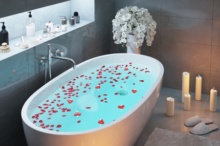 Romantic bath with candles in the evening