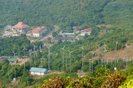 wind turbine in city on island, Thailand photo
