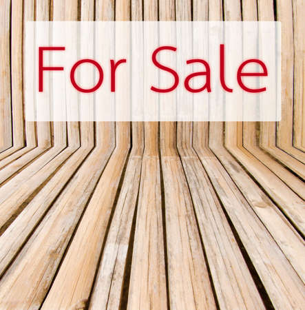Sale tag on wooden background. Stock Photo - 27628635