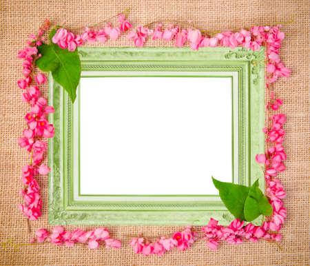 Frame pink flower on sack photo