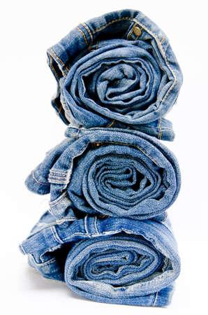 roll blue denim jeans arranged in stack on white background Zdjęcie Seryjne