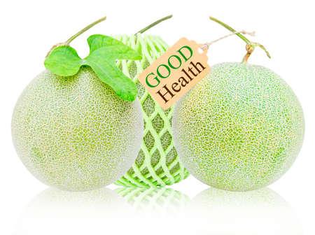 good health: Veel verse meloen en en tag op een witte achtergrond. Goede gezondheid Stockfoto