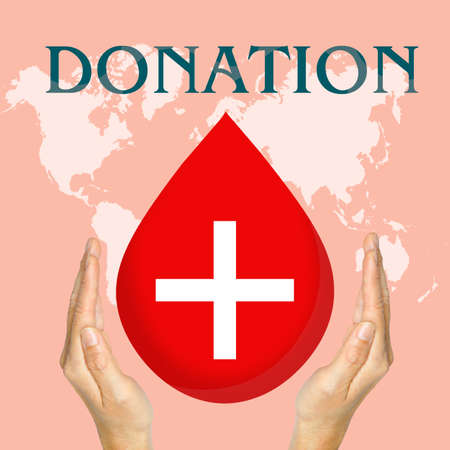 Blood donation and hand medicine help hospital save life heart on map world background photo