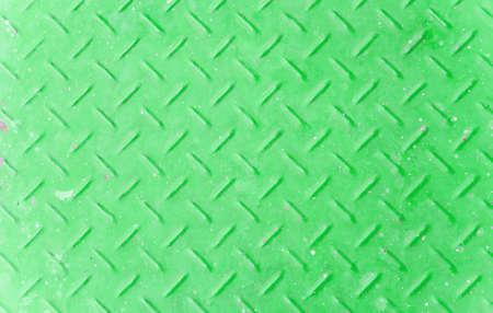 Background of old green color metal diamond plate. Stock Photo