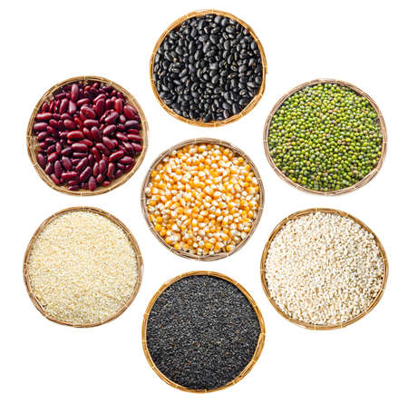 grit: set of cereals seeds beans, red beans, black beans, green beans, sesame, black sesame,  barley grit, in weave basket on white background. Stock Photo