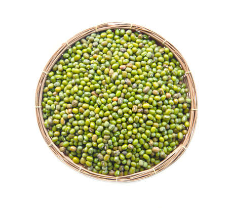 Green mung beans in weave basket on white background. photo