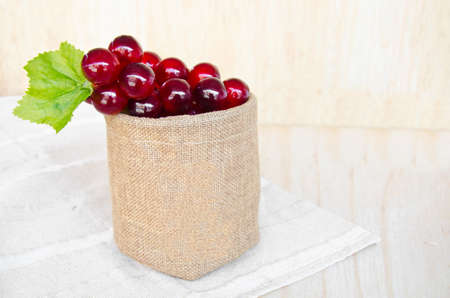 pip: grapes in sack bag on wooden