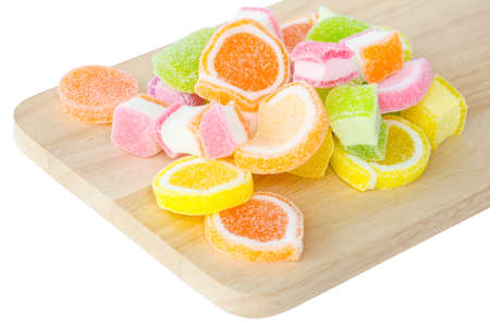 sparce: Sweet jelly sugar on wooden background Stock Photo