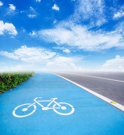 road signal: bicycle symbol lane on blue sky background.