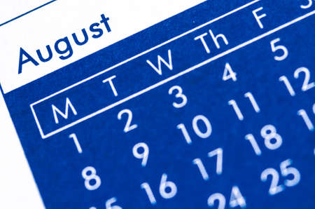 bound: Close up of spiral bound calendar displaying month of August.
