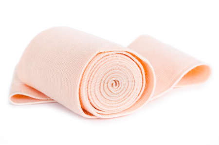 immobilize: Medical bandage roll on white background.