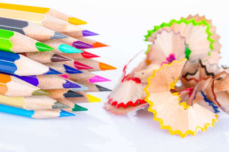 sharpenings: Colored pencil with colorful pencil shavings on white background Stock Photo