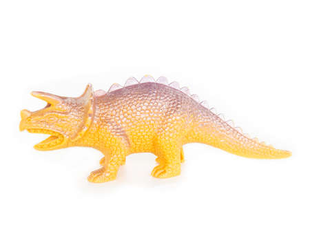 high school series: Plastic dinosaur toy on white background