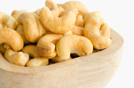 cashew tree: cashew in wooden cup on white background.