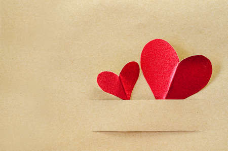 copyspace: Red heart on vintage brown paper background with copyspace Stock Photo