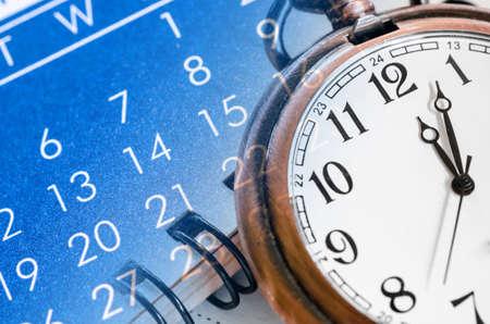 Pocket watch and blue calendar composite. Time concept.