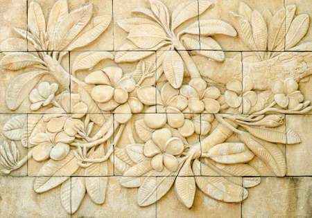bas: Low relief cement Thai style handcraft of plumeria or frangipani flowers