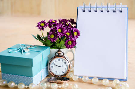 open diary: Open diary, pocket watch, gift box and flower on wooden backgroudn.