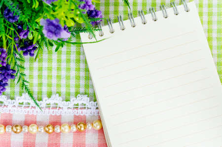 a meeting with a view to marriage: Open diary and violet flower on beautiful background from top view Stock Photo