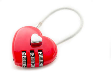 Red master key heart shape lock on white background.