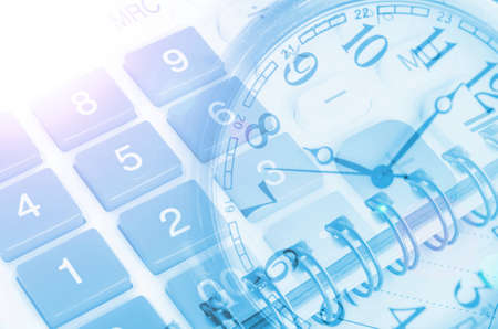 Business concept with clock, calculators and documents Foto de archivo