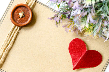 write background: red heart paper and blank brown tag with leaf on whtie background. Stock Photo