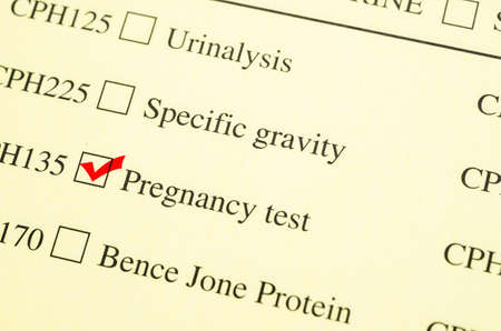 medical test: Check mark Medical form request Pregnancy test in laboratory