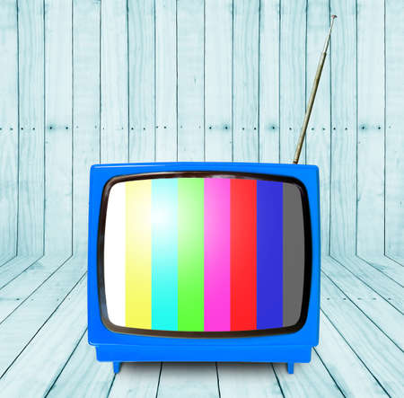 outmoded: room with blue vintage TV. wooden interior background. Stock Photo