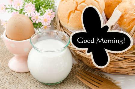 morning breakfast: Good morning and breakfast, bread bun, milk, egg and black tag.