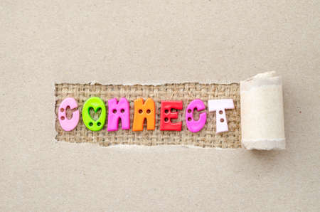 shredded paper: Connect concept. Connect alphabet colorful on sack background in shredded paper