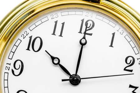 Close up of an Old gold clock face at 10 AM.